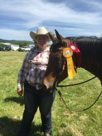 Sam showing off her ribbons